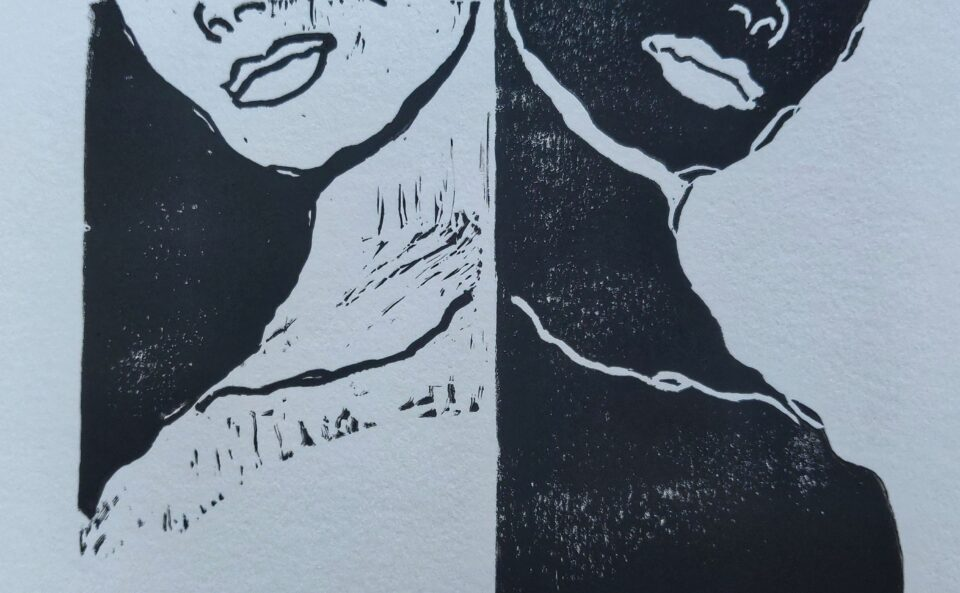 A linocut of a woman's face, white on black back to back with a woman's face black on white